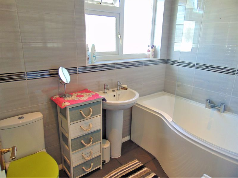 Family Bathroom With White Suite
