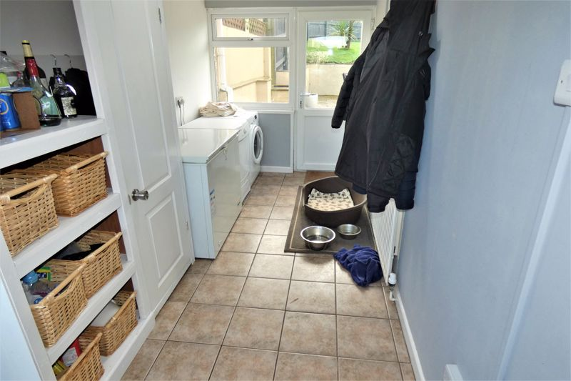 Spacious Utility Room With Front and Back Access
