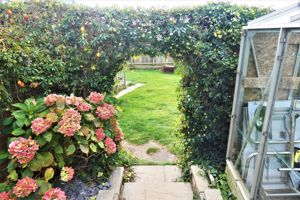 Archway To Lawn Garden And Summer House