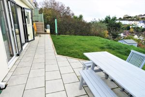 Patio Doors Opening onto Paved Area