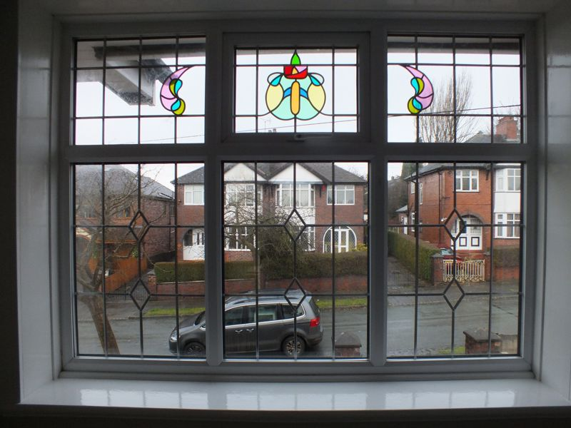 BEDROOM THREE FEATURE STAINED GLASS WNDOW