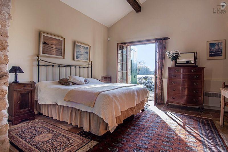 Master bedroom showing door to patio