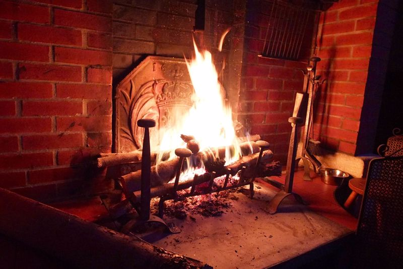 A log fire burning in the grate