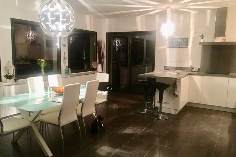 Kitchen and dining area at night