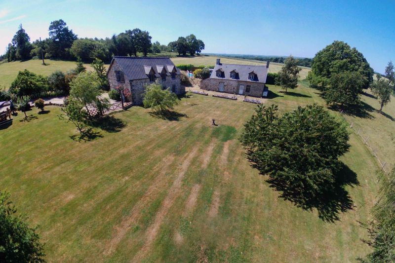 Aerial view of house and barn