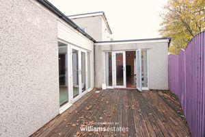 rear enclosed decked patio