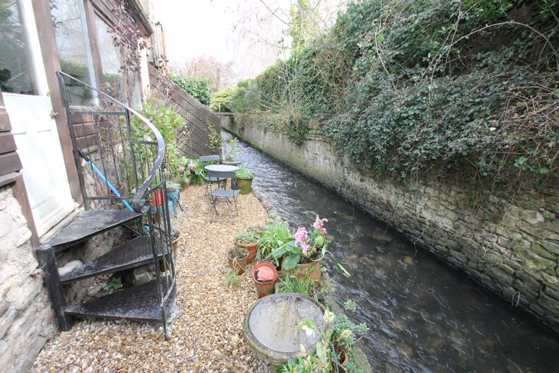 Garden bounded by brook