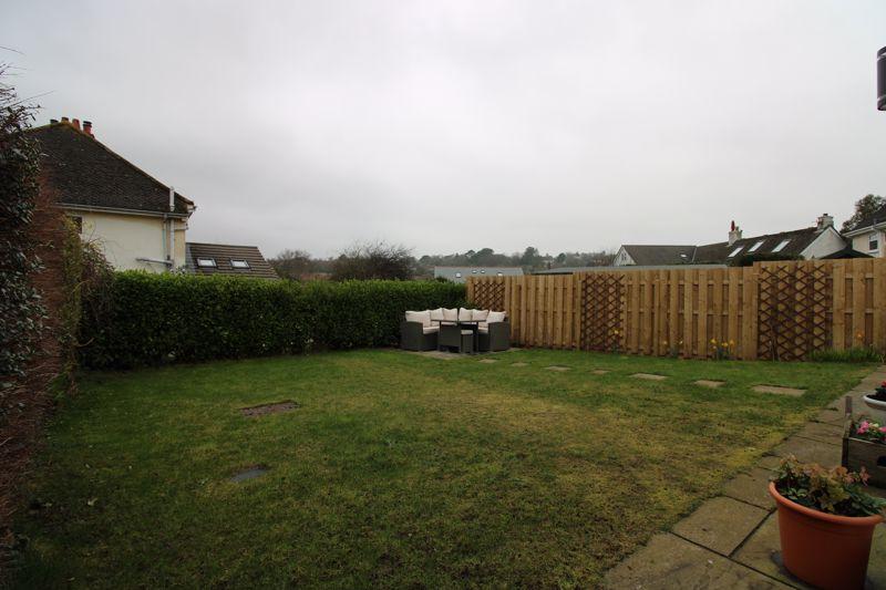 Level enclosed rear garden