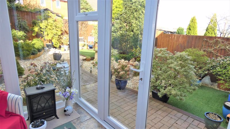 Conservatory Opening Into Rear Garden