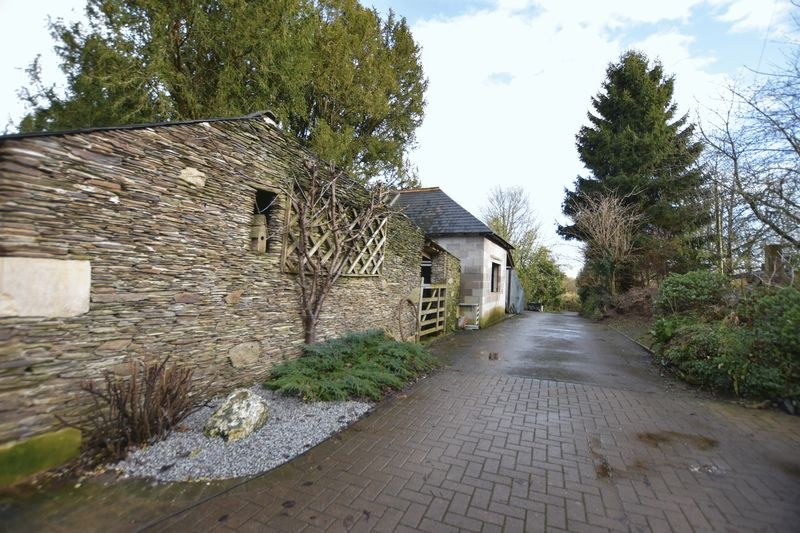 Driveway with outbuildings
