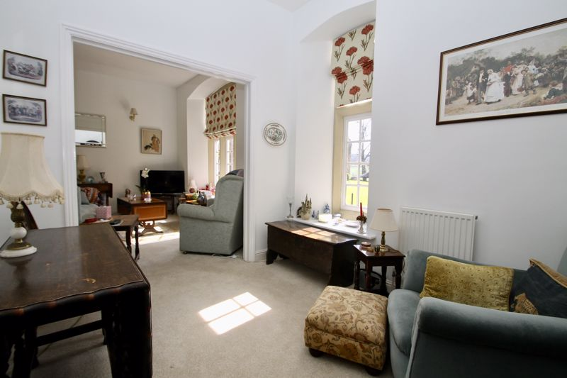 Bedroom 2 or dining room with arch through to sitt