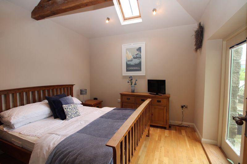 Bedroom with French doors to garden