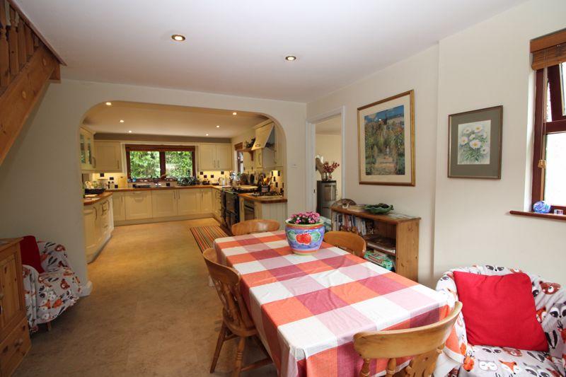 Open plan dining area through to kitchen