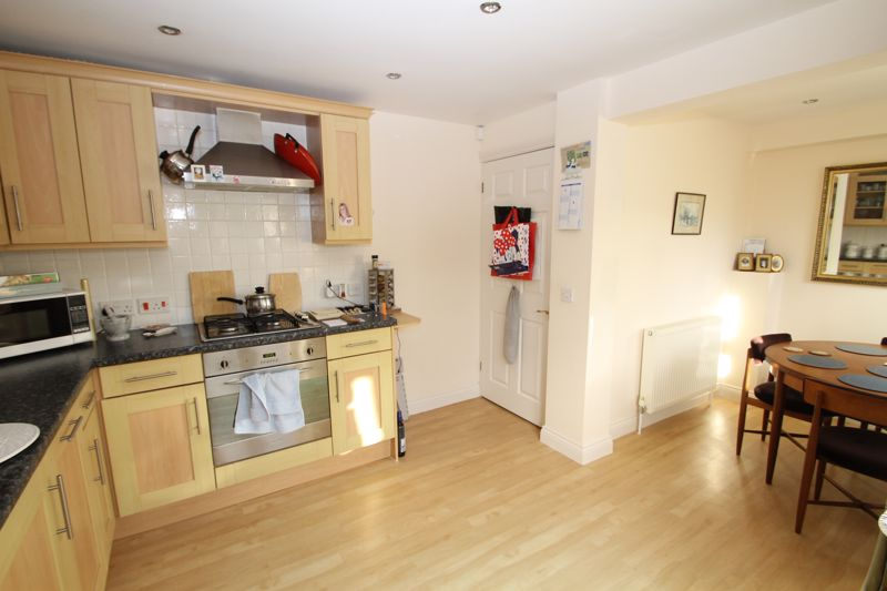 Kitchen with dining area off