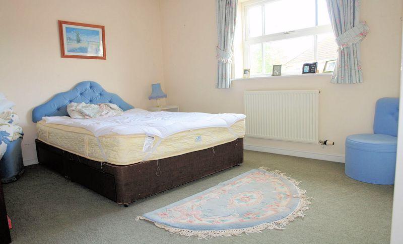 Bedroom 2 of 4 (three double rooms)
