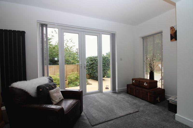 Living area with doors to garden