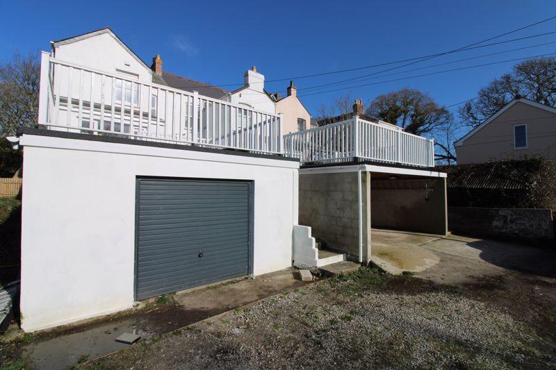 Garage with sun deck above