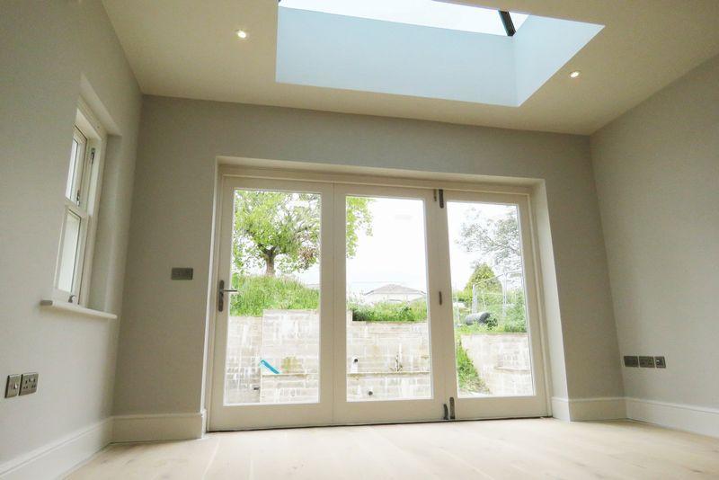 Bi-fold doors and roof light