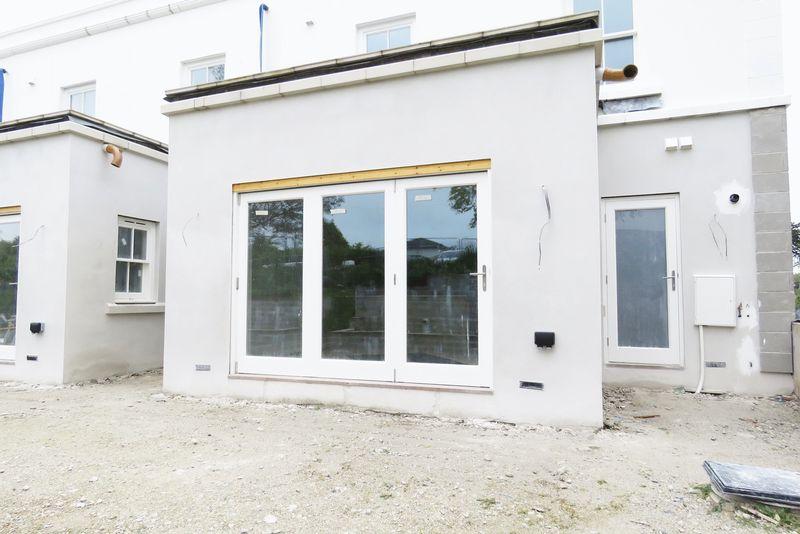 Bifold doors to kitchen and ancillary door to util