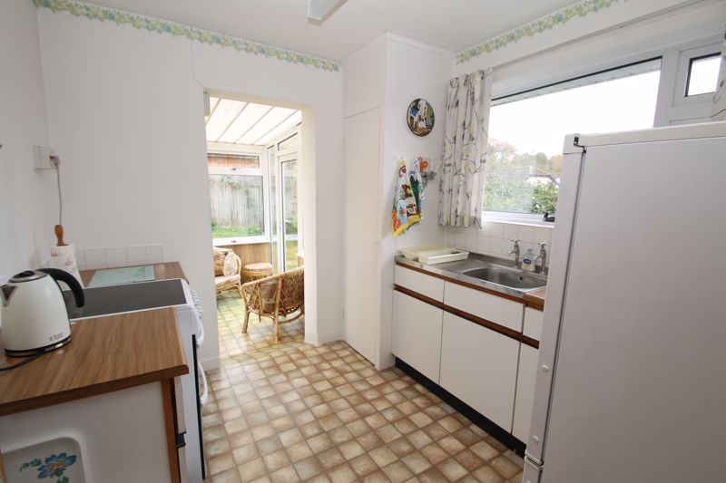 Kitchen with conservatory off