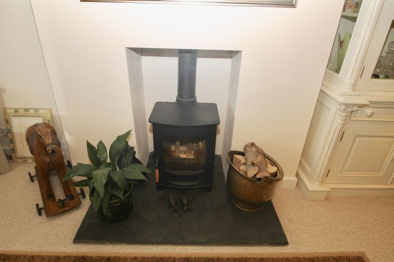 Sitting room fireplace with stove inset