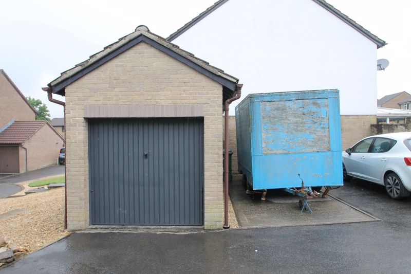 Former garage and parking space