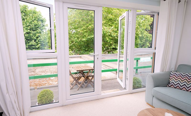French doors and windows to balcony