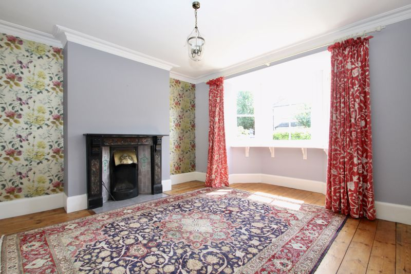 Sitting room with open fire and bay window