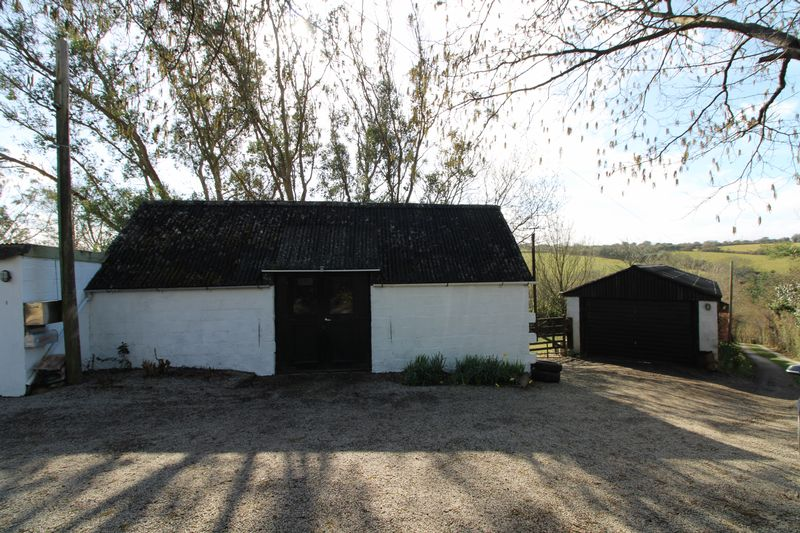 Outbuilding and garage