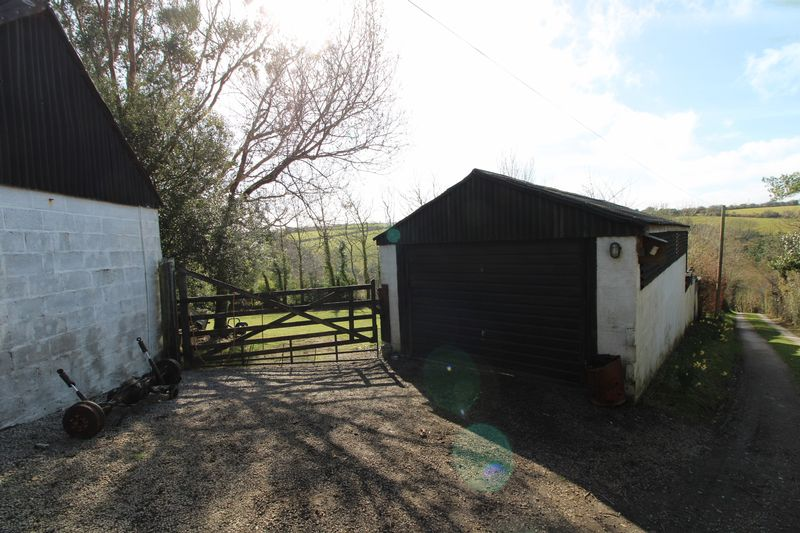 Garage and gate to field