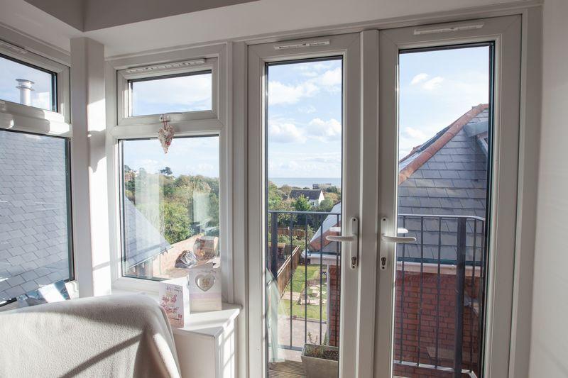 Window & French doors to lounge balcony