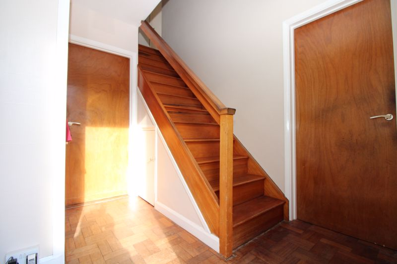 Entrance hall with wood block floor