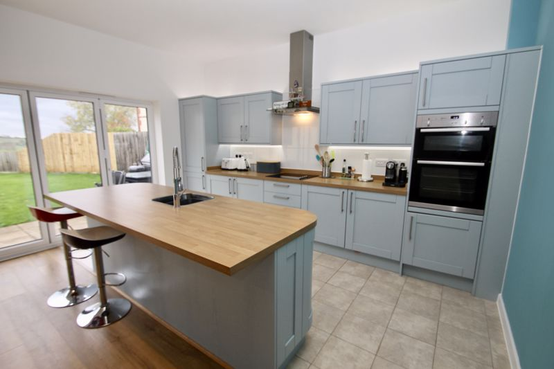 Kitchen area with integrated appliances