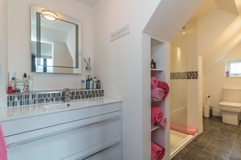 Ensuite shower room to master bedroom