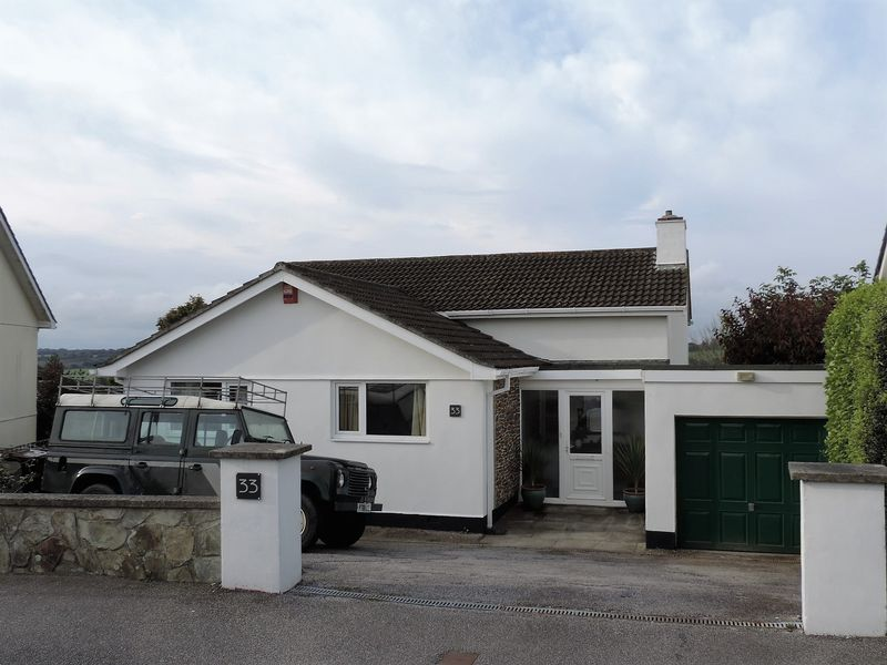 Front, driveway and garage