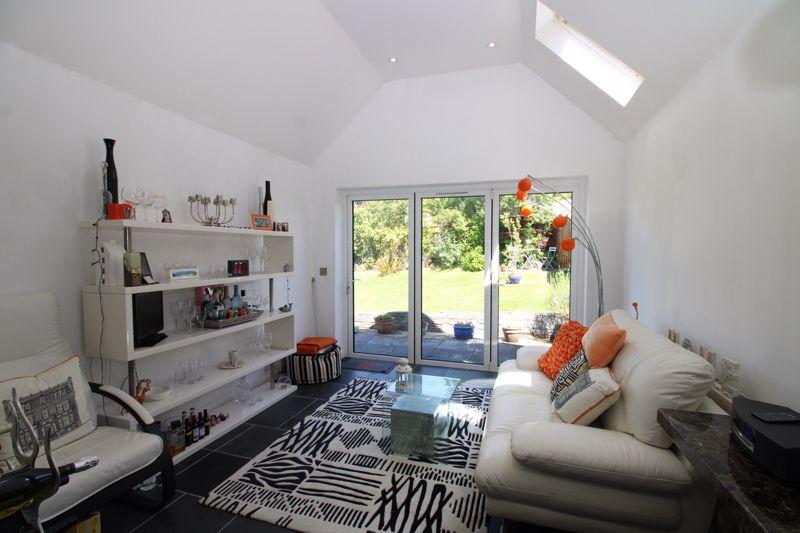 Day room with bifold doors to garden