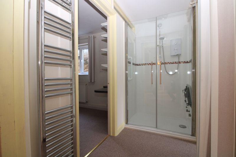 Shower in converted garage area