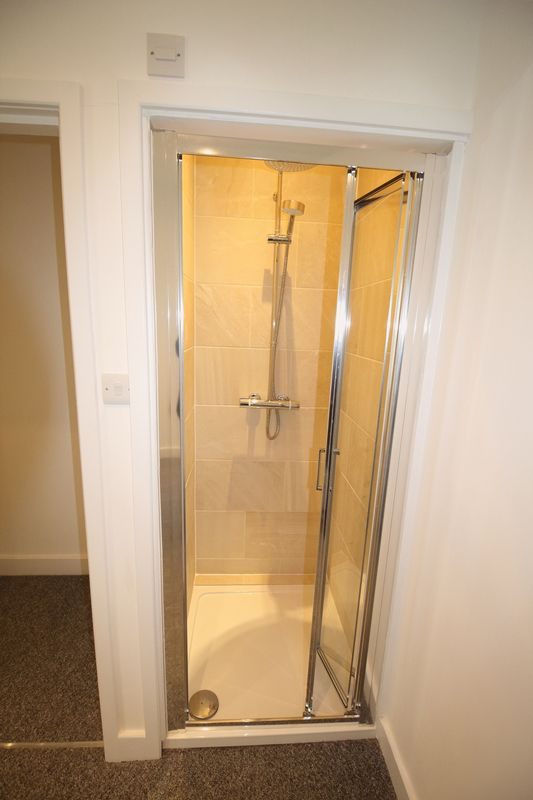 SHOWER IN BEDROOM ONE