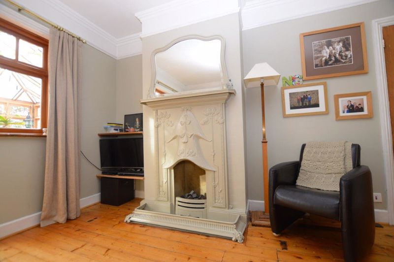 Decorative fireplace surround in dining room