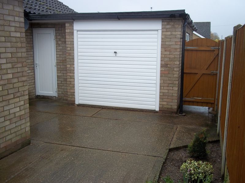 Rear Garage door and storage cupboard