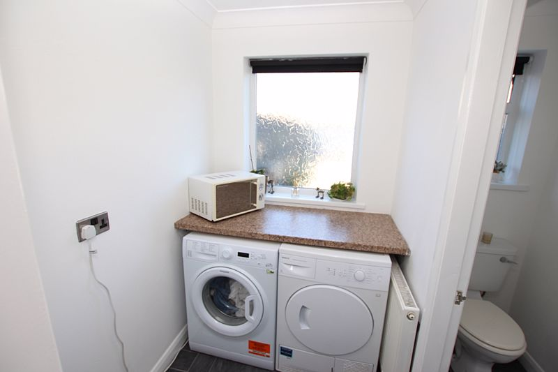 Utility and cloakroom