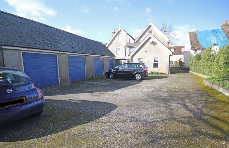 Garage and parking to rear of property