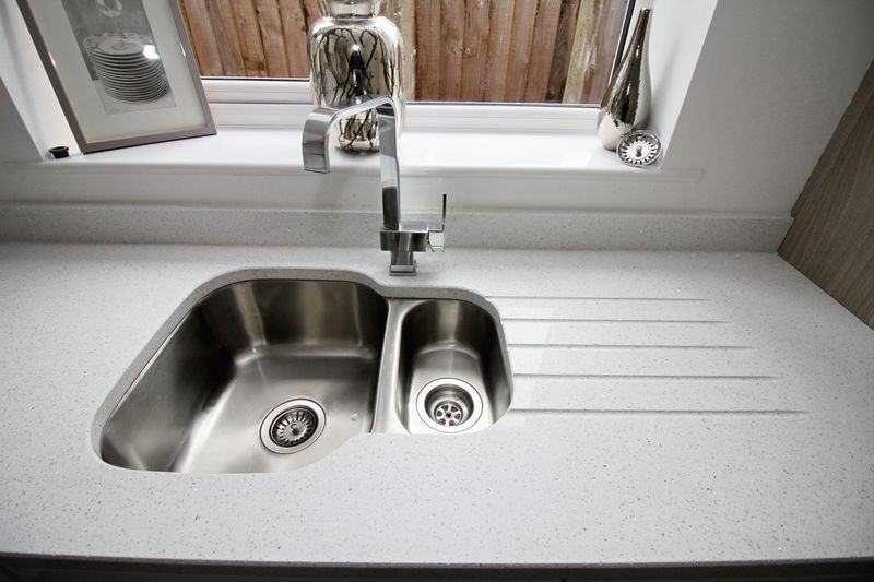 Kitchen sink and work surfaces