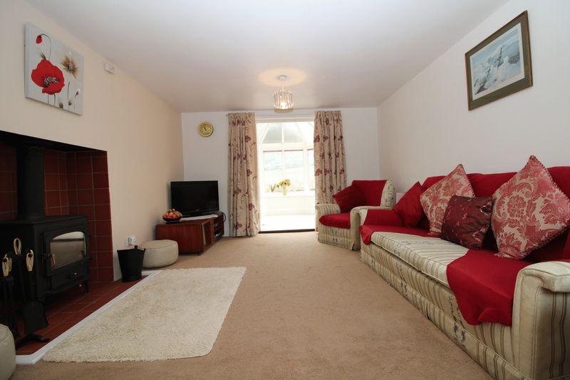 Living room with logburner