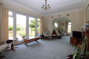 Large living room with French doors to garden