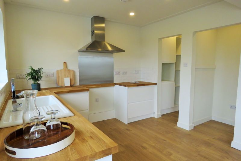 Stylish fitted kitchen with additinal pantry area