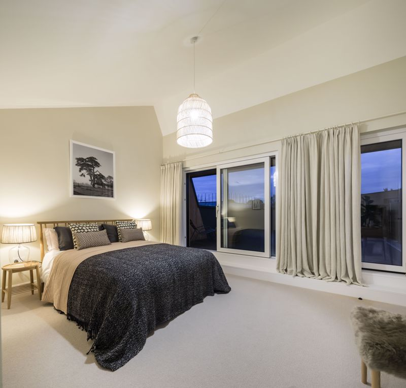 Show home master bedroom night-time