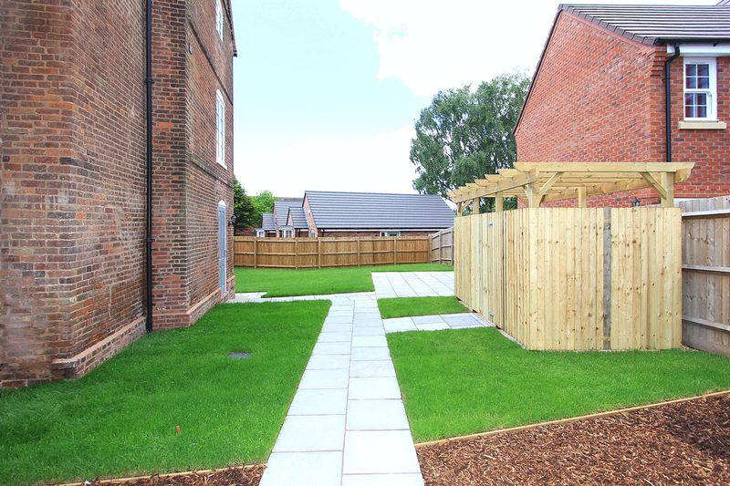 Side communal garden and bin/bike store