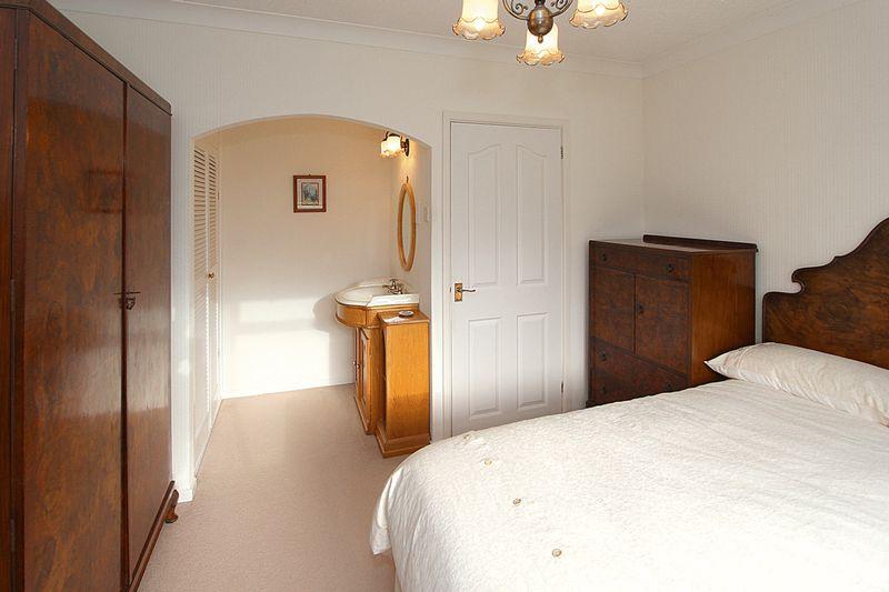 Bedroom 1 showing vanity unit