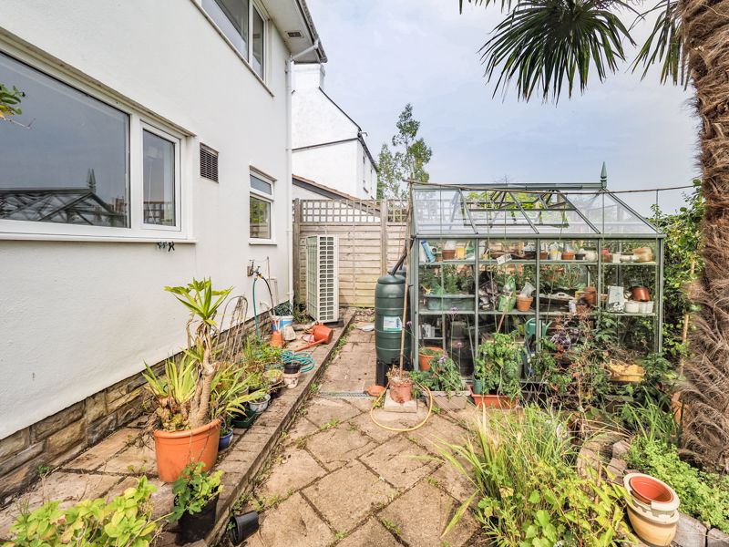 Rear garden and Greenhouse